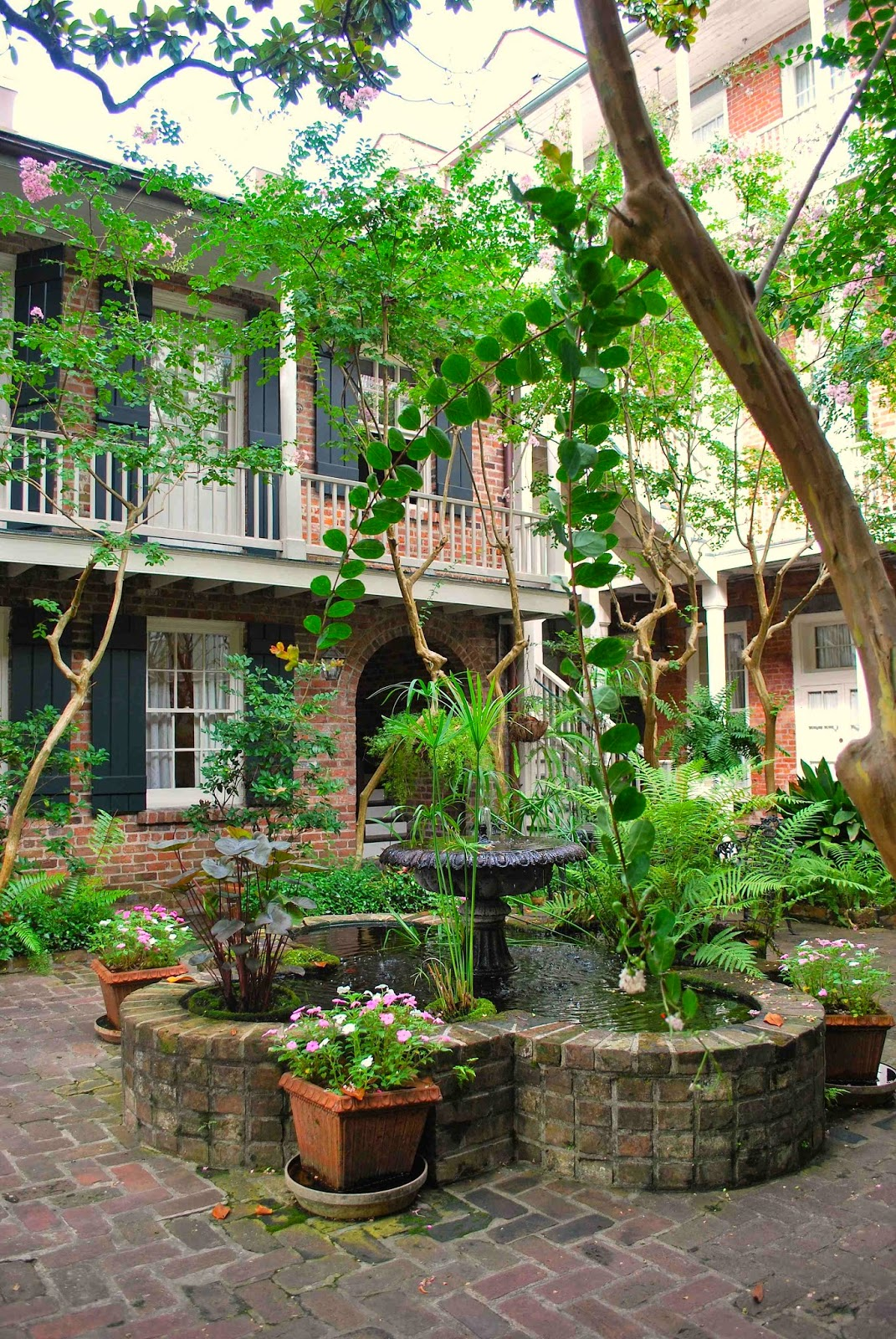 A Quintessential New Orleans Courtyard Is The Centerpiece Of The Place  Du0027Arms Hotel.