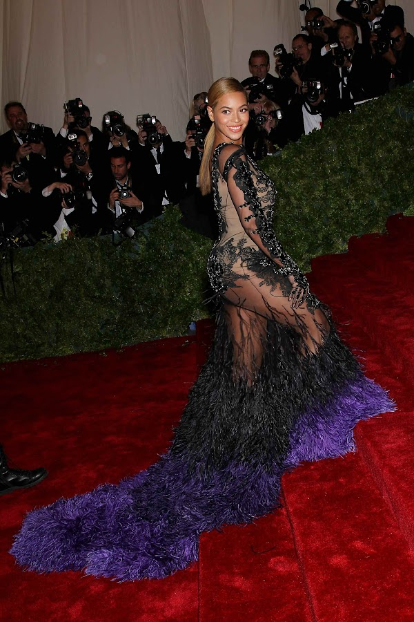 Beyonce in a pecock look at the 2012 Costume Institute Gala