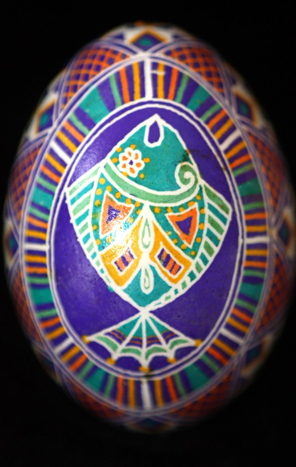 Traditional Fish Motif Ukrainian Egg in Bright Purple, Turquoise, Gold, and Orange