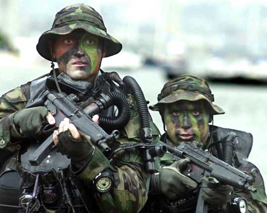 US Navy SEALs armed with MP5s on a training exercise