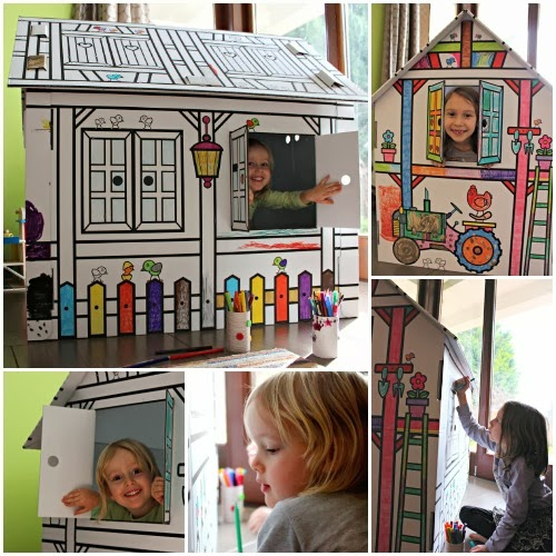 children decorating and playing in a cardboard play house