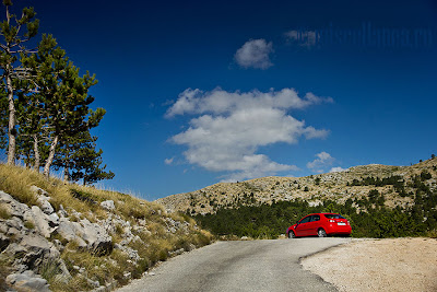 Red car in the middle of nowhere