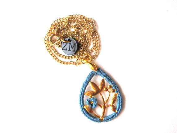 Delicate vintage inspired oriental pendant with crocheted edge and small crocheted flower in blue