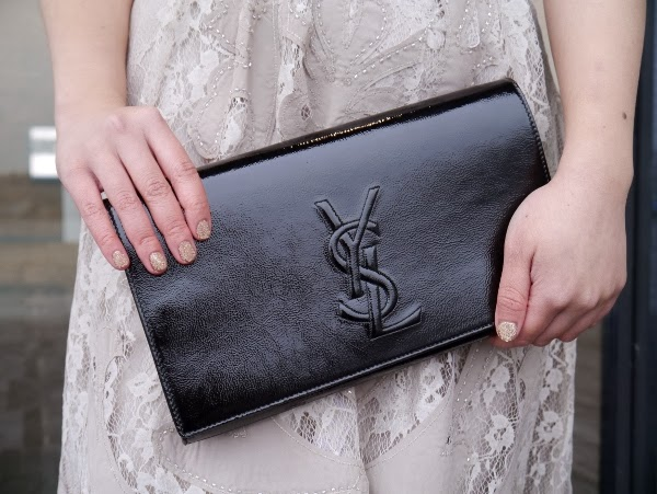 Saint Laurent black patent 'Belle de Jour' clutch, gold lace dress, caviar mani.
