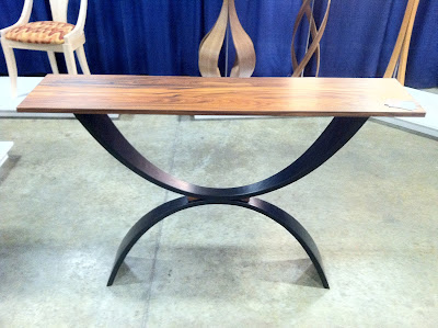 An elegant wooden side table at the New England Home Show