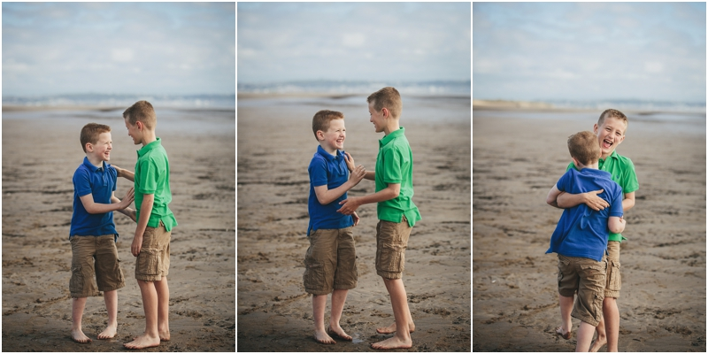 Two brothers tickling each other on Saunton Sands beach