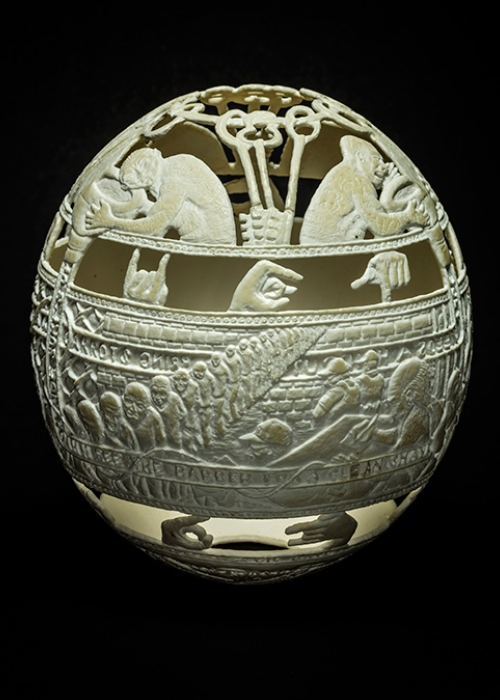 05-Ghost-Communication-Gil-Batle-Hatched-in-Prison-Carvings-on-Ostrich-Eggs-www-designstack-co