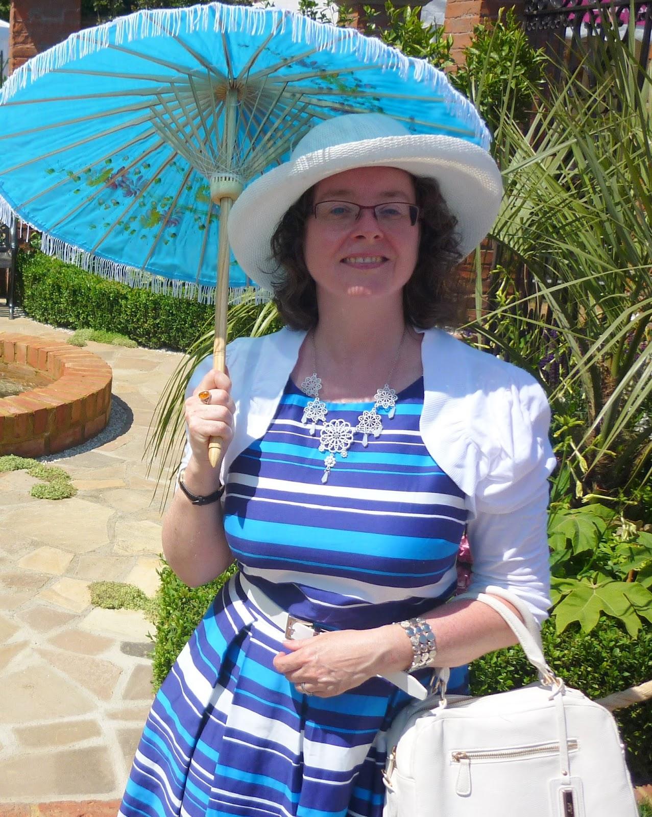 Striped dress, parasol, shrug and bag