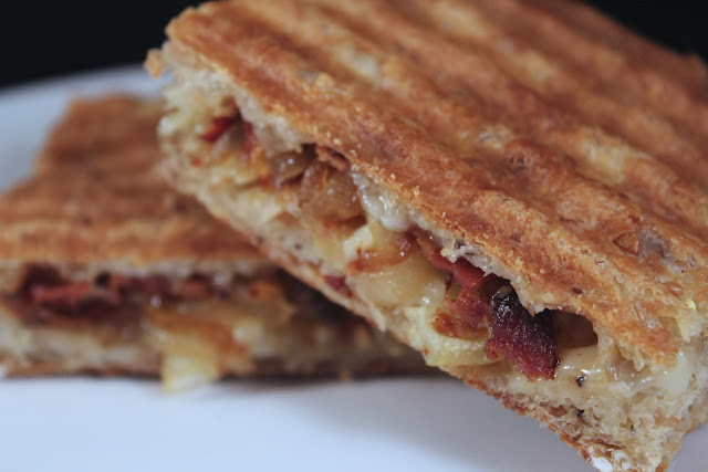 Caramelized onion, bacon, and cheddar panini on seeded focaccia