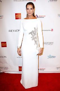 Brooke Shields wearing a white floor lenght dress
