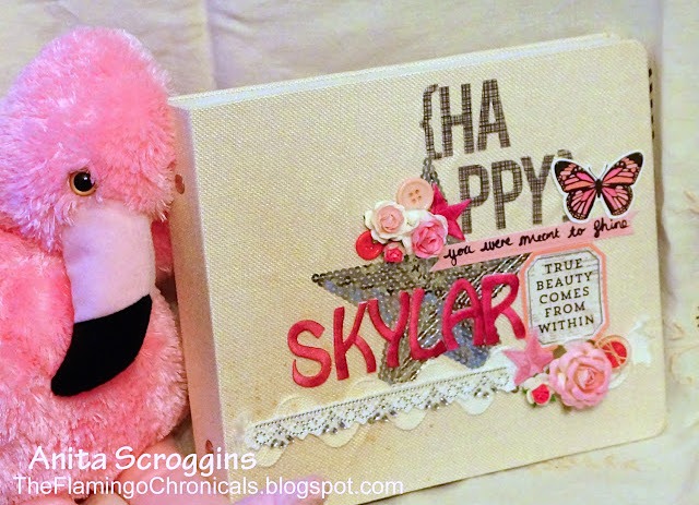 joy embroidered letters on photo album