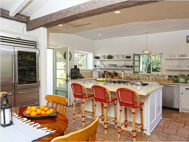 The Country Kitchen Opens Into A Spacious Dining Room Featuring Large Stone Fireplace
