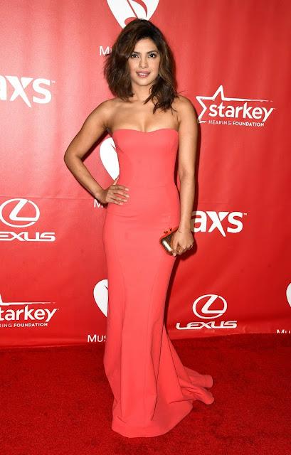 Priyanka Chopra in Orange Gown 2015 MusiCares Person Of The Year Gala Honoring Bob Dylan Los Angeles+4.jpg