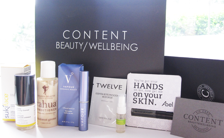 A picture of Content Beauty & Wellbeing Goody Bag with Suki Skincare, Rahua, Vapour Organic Illusionist Concealer, Twelve moisturiser, Tata Harper, Abel Organics, VIP card