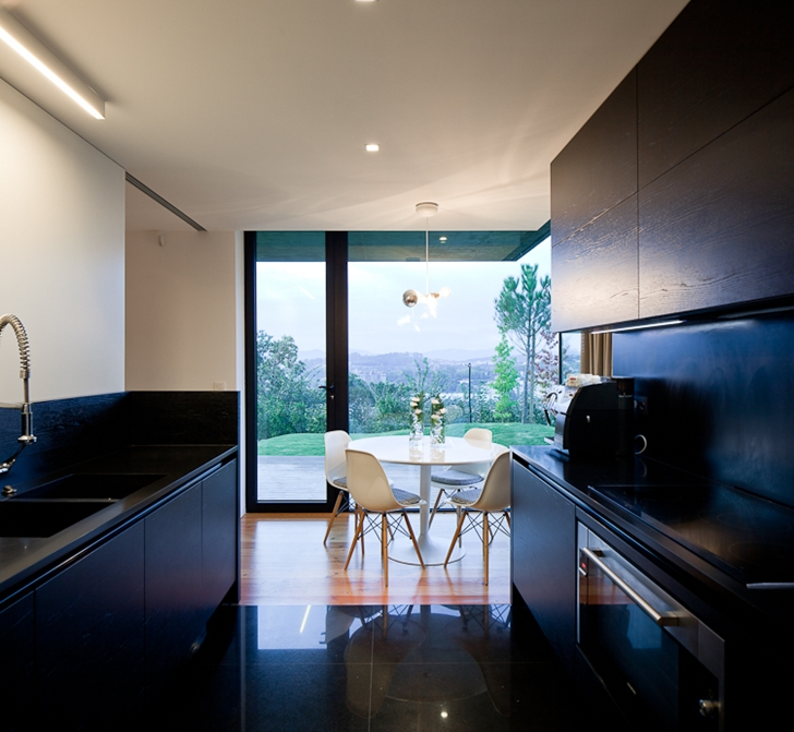 Kitchen in Black Concrete House by Pitagoras Arquitectos