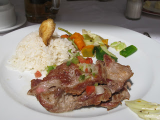 Pork with rice and green salad at La Imprenta in Habana Vieja
