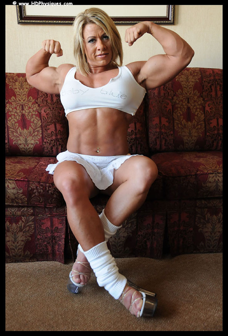 Julie Bourassa Flexing Her Biceps And Ripped Abs