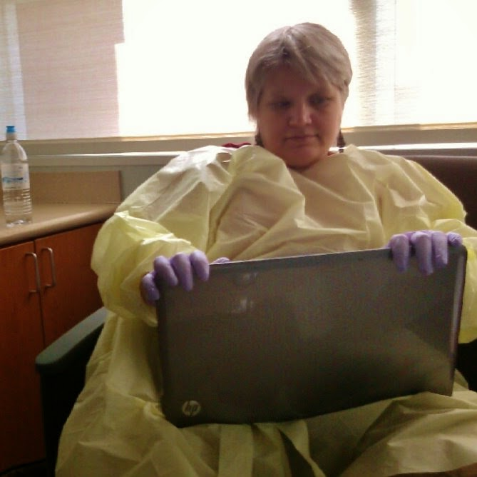 author sitting in hospital with laptop