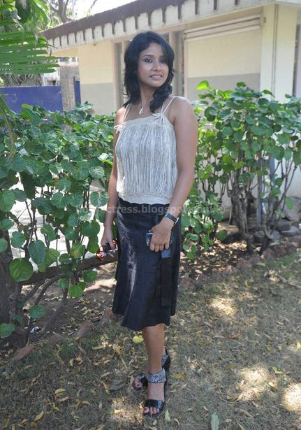 Urmila in mini skirt and sleeveless top hot photos
