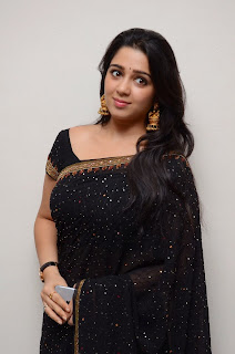 Actress Charmi Kaur Pictures in Black Saree at Jyothilakshmi Trailer Launch  1
