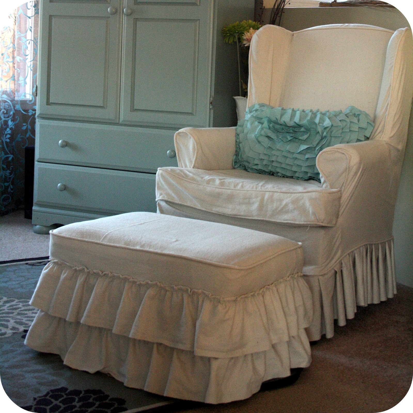 Ruffled Ottoman Slipcover... looks very cute with just the ruffles, but I  wanted to add just a little something more. - Creating At Home: DIY :: Ruffles And Rosettes Slipcovered Ottoman