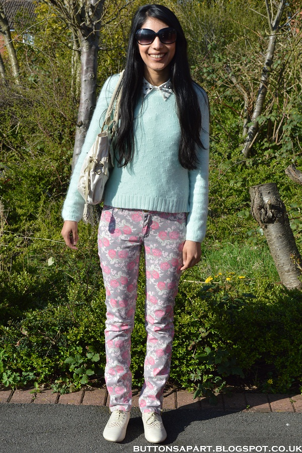 a picture of an outfit with  floral print jeans and mint green jumper
