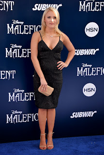 emily osment maleficent world premiere in los angeles 6.jpg