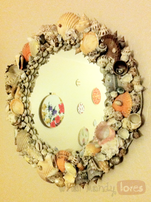 DIY Seashell Wall Mirror via www.whatmandyloves.com
