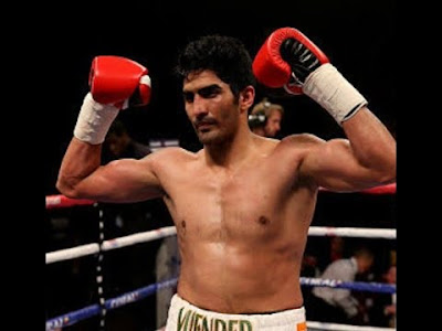 """Indian boxer Vijender Singh scored his third successive knockout triumph on Saturday by clinically punishing Bulgaria's Samet Hyuseinov, who had promised to send him back to India """"beaten"""" and """"broken"""".  The six-round contest ended after just two rounds, when the referee stepped in to declare win for Vijender Singh. In the brief contest the Indian boxer was on a rampage and the Bulgarian challenger was cowering at the ropes taking the assault meekly."""