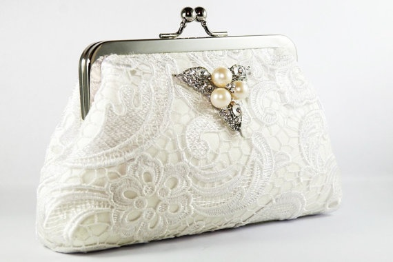 http://www.etsy.com/listing/58845660/ivory-lace-bridal-clutch-with-pearl?utm_source=Pinterest&utm_medium=PageTools&utm_campaign=Share