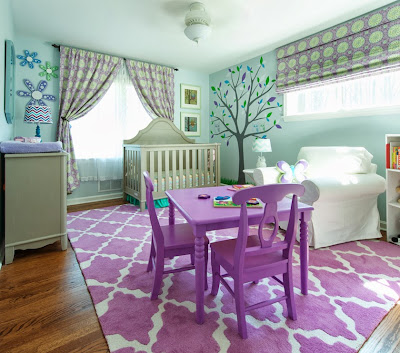 fresh child room design in purple and turquiose and surrounded by attractive wall decorations