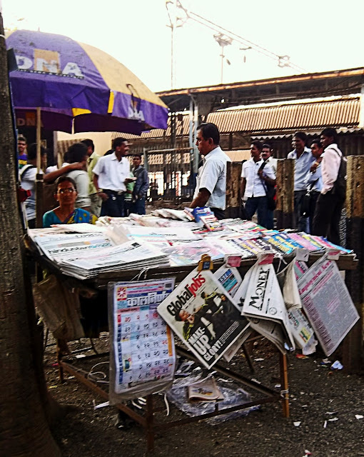 woman newspaper vendor