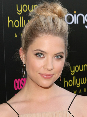 Ashley Benson pulls her blonde locks into a loose topknot for a wispy angelic look