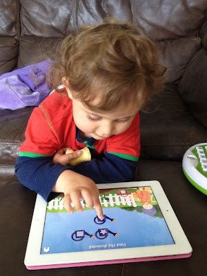 Ben enjoying playing the Grandma's Garden app, kids apps, educational apps