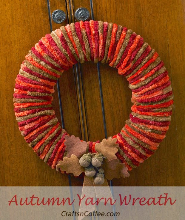 http://craftsncoffee.com/2013/08/16/a-beautiful-fall-yarn-wreath-you-can-make-in-an-afternoon/