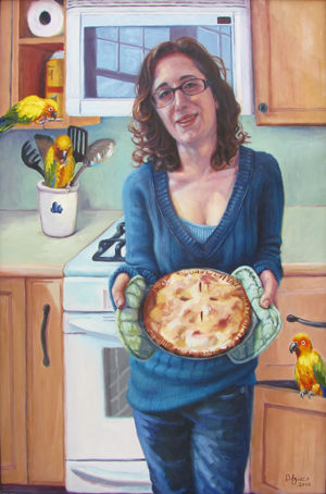 lady in blue holding a freshly baked pie