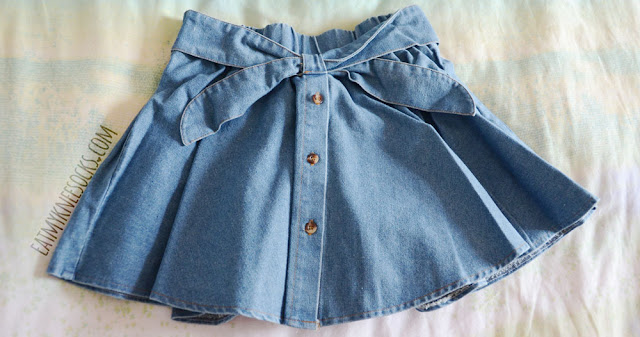 The denim waist-bow buttoned skirt from Yumart is a super cute, casual skirt for ulzzang fashion lovers.