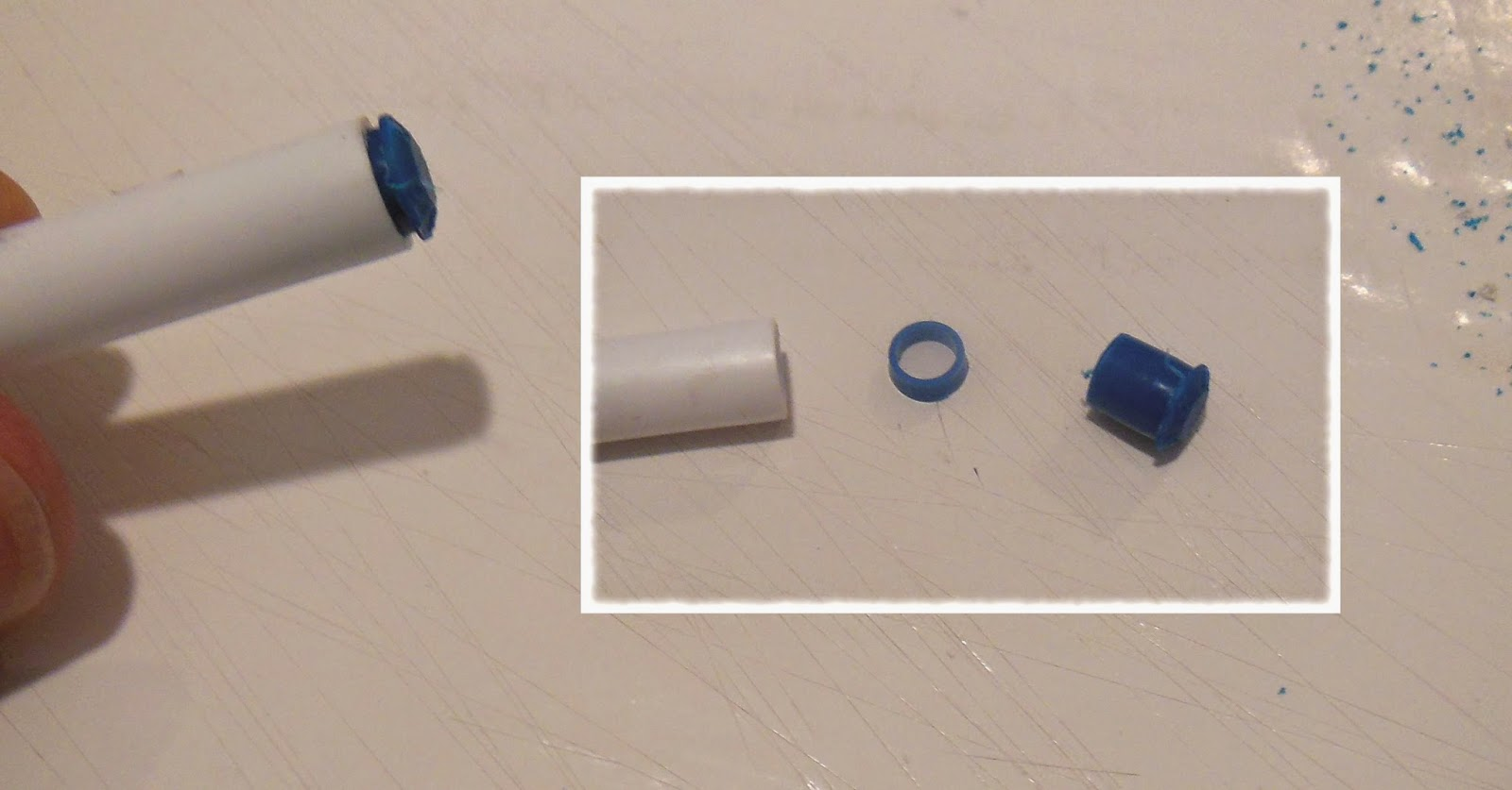 Work the blue end plug out with a knife blade.