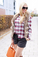 Fur vest with plaid shirt