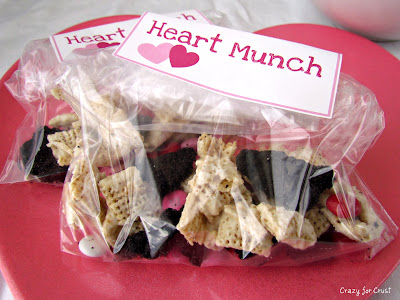 chex mix made with oreo crust in baggies with tag on heart plate