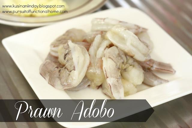 Prawn Adobo. Raw prawn/ shrimp on a white small plate