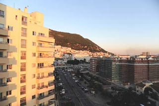 sunset gibraltar high rise