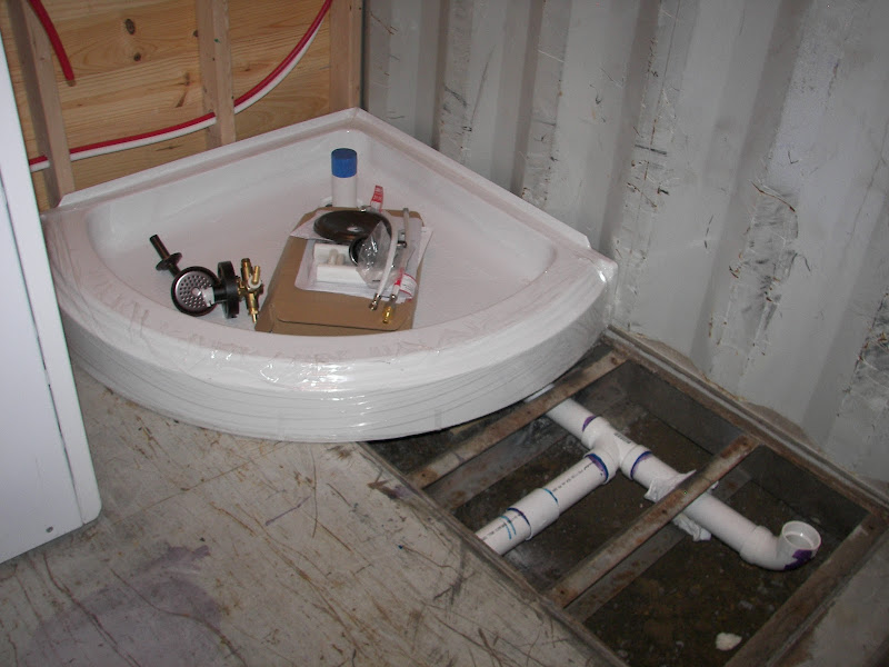 Corner shower stall drain pipe installed. The support beams were cut  title=
