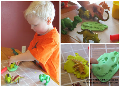making prints and tracks in play-doh with toy dinosaurs