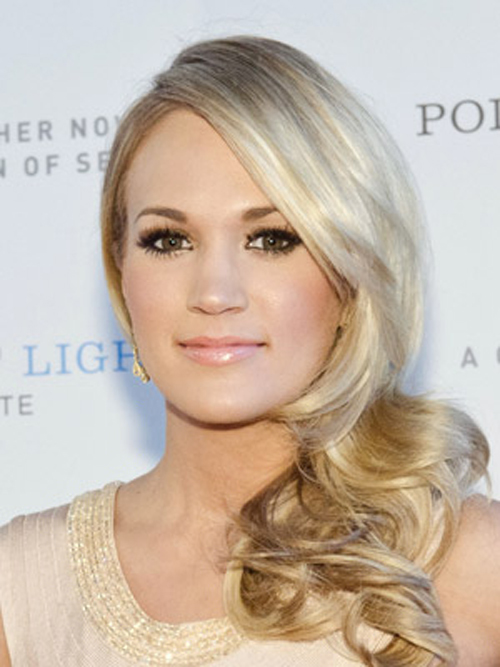 Carrie Underwood's side-swept curls sparkle with a bright platinum shine.