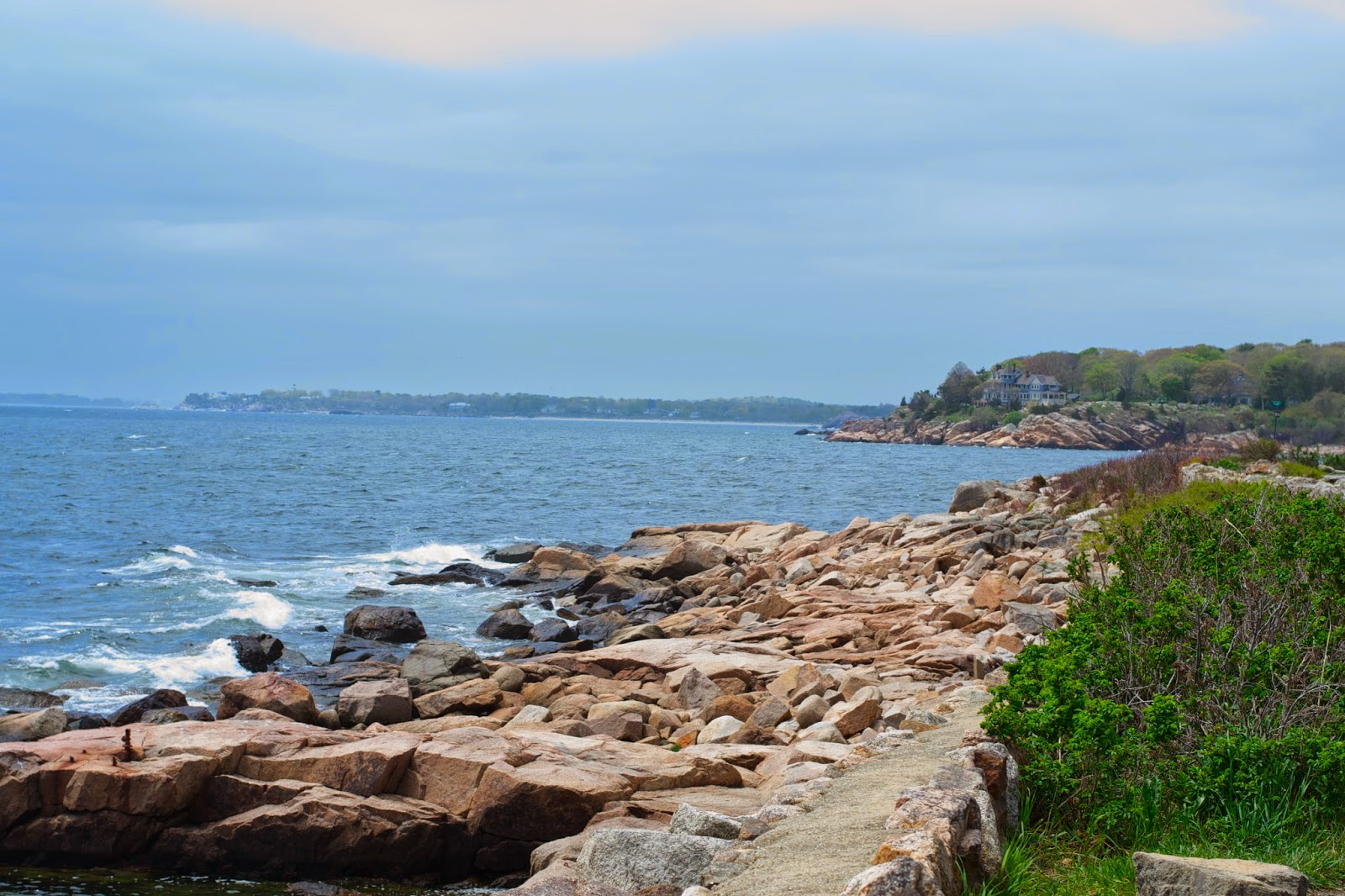 A view along the coastal road. Looking out at the ocean and towards a neighboring town.