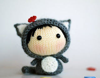 http://www.ravelry.com/patterns/library/gray-girl-cat--knitted-round--toy-from-the-tanoshi-series