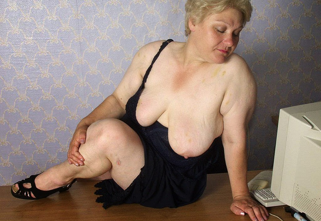 image Grandma with big breasts rips open pantyhose