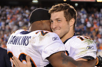 Brian Dawkins and Tebow