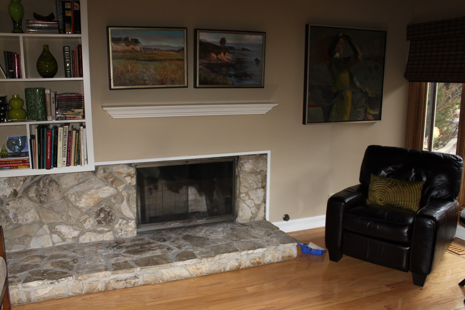 using a fireplace insert to heat a mid century modern living room